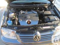 Make Volkswagen Model Jetta Year 2003 Colour dark grey