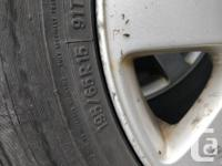 Set of 4 wheels and tires off a Passat. Factory alloy for sale  British Columbia
