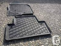For Sale.  Four black rubber Volvo rubber flooring