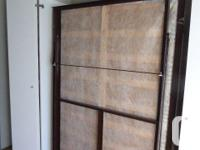 Pull down space saving murphy bed also called a wall