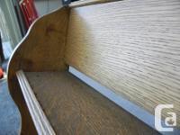solid oak decorative wall shelving unit. Hangs easily