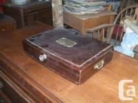 Pic #1 shows a walnut cutlery box  with a price of $25