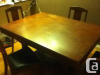 very good cond. w/ rare butterfly extension...4 chairs