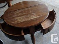 Walnut round table that can be folded down halfway to