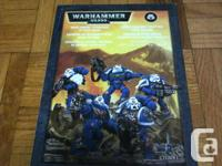 Selling several Warhammer 40,000 space marine kits.