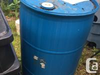Two water barrels two (one side is flat to fit against