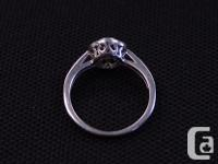 **This beautiful engagement ring is white gold with a