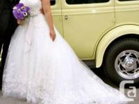 One stunning ivory designer bridal gown fit