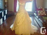 This is a Size 4-6 corset back wedding dress. The