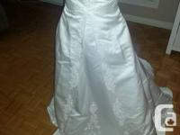 This wedding dress was never worn except for once when