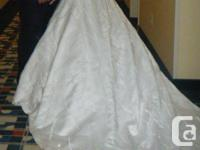 Beautiful ivory wedding dress with lots of pearls,