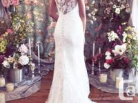 Brand new mermaid v-neck wedding dress. Never worn tags