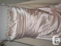 This is a beautiful wedding dress in a pale blush