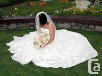 Gorgeous designer wedding gown by Alfred Angelo in