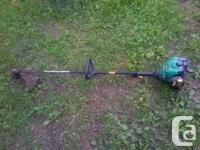 """Weed Eater gas trimmer, 25cc engine, 17"""" cut diameter."""