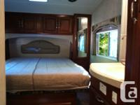 Outstanding 35'5 5th wheel toyhauler with different 12