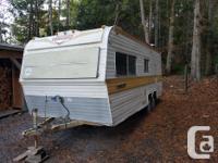 Very well used older trailer. Roof leaks, nothing