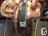 "151/2"" Comanche western saddle, basket weave tooling"