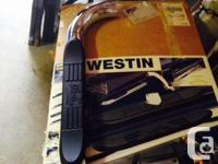 These brand new in the box Westin E series step up Bars