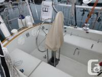 Complete Edson wheel steering system for sailboat.