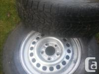 215/70/15. Tires on rims just half worn. Suits Buick