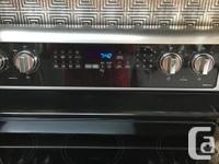 Newly new smooth top electric stove. Convection oven