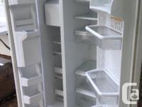 Newer whirlpool fridge for sale. Immaculate