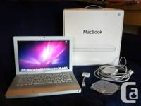 This 2008 White Macbook is in good working condition