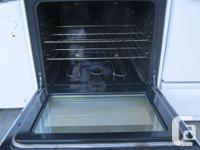 Newer white Kenmore smooth-top range. Very clean and