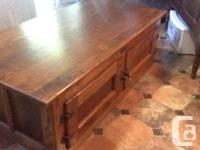 Sturdy solid oak coffee table with cabinets. Good