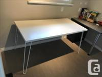 Sleek white table that can be used as a large working