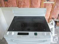 """This is a White KitchenAid convection stove 30"""" model"""