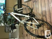 The bike is a 21 speed White Raleigh Hybrid (suspension