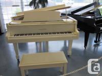 """White Samick 5'8"""" grand piano in excellent condition."""