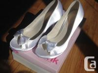 Selling these beautiful shoes. They were only worn once