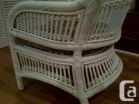 Old, large, heavy, very well-made sturdy wicker chair.