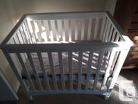 White wooden baby crib with bed cushin and cushin cover for sale  British Columbia