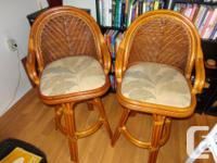 Available For Sale. 2 BROWN WICKER BAR STOOLS IN