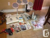 WII game console, games and accessories Includes: