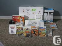 Nintendo Wii with Wii Fit board and also numerous