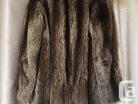 "Size 12 Sleeves: 15"" Length: 32"" Coat with earmuffs"