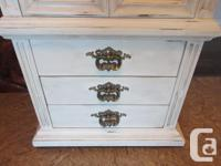 Vintage, solid wood cabinet that has been converted to