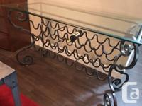 Solid wrought iron wine rack.. holds 24 bottles of