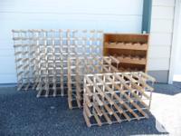 several wine racks for sale: -2 racks that hold 64