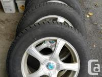 Set of four Bridgestone Blizzak winter tires on alloy