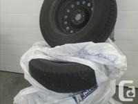 Set of four tires and rims used on a 2012 Hyundai Santa