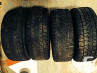 4 wintertime tires on rims 3 in decent shape one in