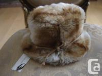 New WITH TAGS and never used. Faux hair-- Device