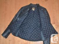 Leather Ladies Motorcycle jacket made by Wolff. Very