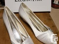 Brand new in box shoes by Elegant Park White with